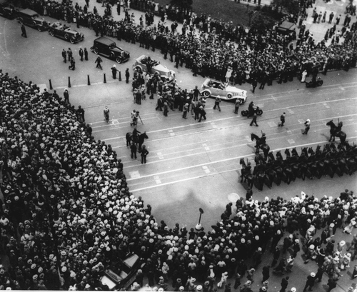 View shows part of thousands who assembled at New York's City Hall June 20, 1932 to join in welcome accorded Mrs. Amelia Earhart Putnam, after her record trans-Atlantic solo flight. In center are official cars entering the City Hall Plaza where the flier was welcomed by Mayor James. J. Walker. (AP Photo)