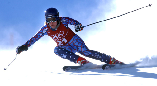 Caroline Lalive, of the USA, speeds down the course during a downhill training run in Snowbasin, Utah Saturday, Feb. 9, 2002 at the Salt Lake City Winter Olympics. Lalive finished with the second best time behind compatriot Picabo Street.  (AP Photo/Alessandro Trovati)