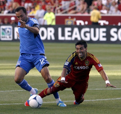 Real Salt Lake midfielder Javier Morales is put down at the top of the box with no call by San Jose Earthquakes defender Ramiro Corrales in the first half at Rio Tinto Stadium in Sandy, Utah. Stephen Holt / Special to the tribune