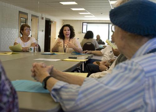 Paul Fraughton | Salt Lake Tribune Sarah Mogzec of Valley Mental Health, center, talks to seniors  attending a class at River's Bend Senior Center. The  class,