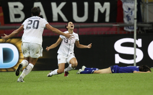 United States' Abby Wambach, left, runs to celebrate with United States' Alex Morgan after she scored the opening goal during the final match between Japan and the United States at the Women's Soccer World Cup in Frankfurt, Germany, Sunday, July 17, 2011. (AP Photo/Michael Probst)