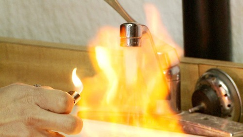 A man sets his tap water on fire, in a scene from Josh Fox's 2010 documentary