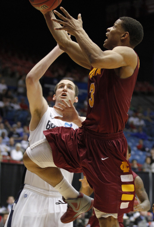 AP file photo Iona's Scott Machado, right drives against BYU's Noah Hartsock during the teams' NCAA Tournament game in March. The Jazz worked out Machado, a point guard, Friday.