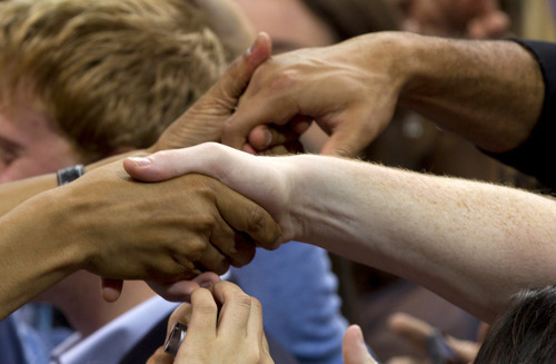 President Barack Obama shakes hands after speaking at the University of North Carolina at Chapel Hill, Tuesday, April 24, 2012.  (AP Photo/Carolyn Kaster)