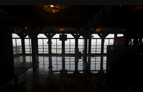 Water sneaks into a restaurant in Cedar Key, Fla. as Tropical Storm Debby churns on the Florida Gulf coast waiting to makes its way across the Gulf of Mexico early Sunday, June 24, 2012. (AP Photo/Phil Sandlin)