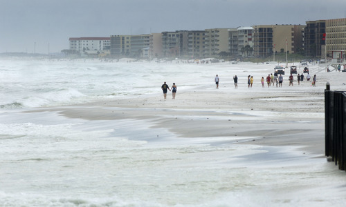 Waves crash against the coast in Fort Walton Beach, Fla. as wind, waves, and storm from Tropical Storm Debby pound the Florida panhandle Sunday, June 24, 2012. Louisiana's governor declared a state of emergency as the storm threatens to flood low-lying coastal areas. (AP Photo/Northwest Florida Daily, Devon Ravine)