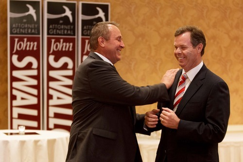 Trent Nelson  |  The Salt Lake Tribune  Utah Attorney General Mark Shurtleff, left, and Utah Attorney General candidate John Swallow share a laugh on Tuesday night at the Little America Hotel in Salt Lake City.