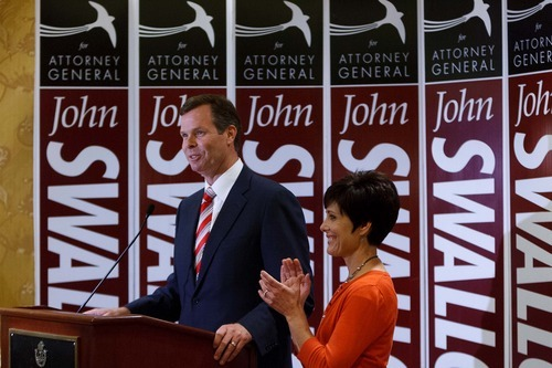 Trent Nelson  |  The Salt Lake Tribune Utah Attorney General candidate John Swallow makes his victory speech on the night of the primary election, at the Little America Hotel in Salt Lake City, Utah, Tuesday, June 26, 2012. Swallow's wife, Suzanne Swallow is at right.