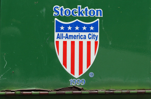 A payment drop box near city hall sports the Stockton All-America City logo Tuesday, June 26, 2012, in Stockton, Calif. Stockton officials continue to grapple with the city's financial plight, struggling to restructure millions of dollars of debt threatening to turn the city with the nation's second highest foreclosure rate into the largest American city to file for bankruptcy. (AP Photo/Ben Margot)
