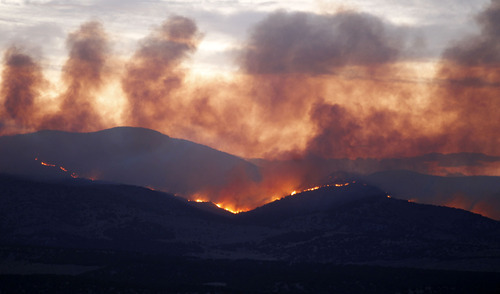 Al Hartmann  |  The Salt Lake Tribune   Wood Hollow fire continues to burn Sunday night several miles northwest of Fairview.