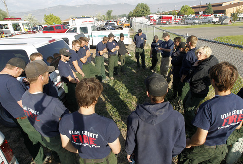 Al Hartmann  |  The Salt Lake Tribune   Wildland firefighters from multiple agencies gather at the Moroni Elementary School in Moroni Monday morning June 25 to organize and equip themsleves before going out to fight the Wood Hollow fire.