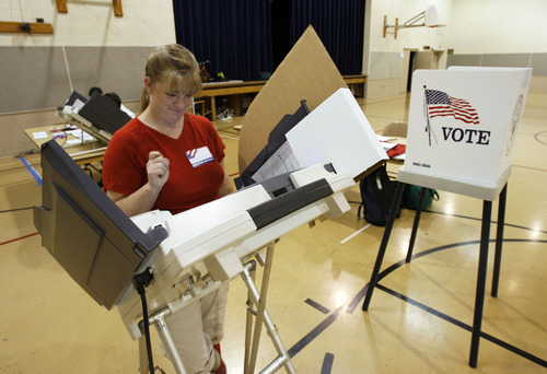 Francisco Kjolseth     The Salt Lake Tribune Election official Mariana Ahlers takes advantage of no voters 20 minutes after opening her assigned polling place at the Kearns St. Ann's School on Tuesday, June 26, 2012, to cast the first vote there for the primary elections.