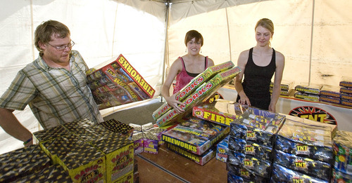 Paul Fraughton | Salt Lake Tribune Christopher Howard, Ashley Porter, and Heather Smith,stock the fireworks stand at 1700 South and 900East in Salt Lake City. The three University of Utah students are selling fireworks as a fundraiser for the university's music department. The fireworks will go on sale tomorrow, June 26th.  Monday, June 25, 2012