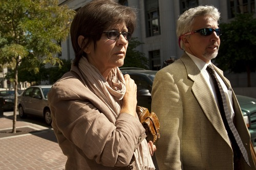 Chris Detrick  |  Tribune file photo Jeanne Redd and defense attorney Mark Moffat leave the federal courthouse in Salt Lake City in 2009. She is suing the federal government for wrongful death and other claims related to husband James Redd, who killed himself after a 2009 crackdown against illegal artifact trafficking.