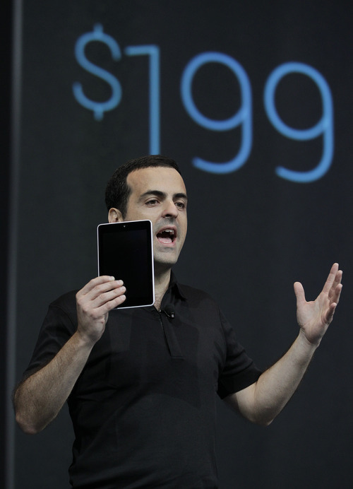 Hugo Barra, Director of Google Product Management, holds up the new Google Nexus7 that will sell for $199, at the Google I/O conference in San Francisco, Wednesday, June 27, 2012. The tablet will have a screen that measures 7 inches diagonally, smaller than the nearly 10 inches on Apple Inc.'s popular iPad. That means it's more likely to challenge Amazon.com Inc.'s Kindle Fire, which is also 7 inches.   (AP Photo/Paul Sakuma)