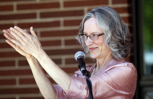 Al Hartmann  |  The Salt Lake Tribune file photo Anne Burkholder, YWCA Chief Executive officer applauds the Salt Lake City YWCA's new Center for Families on June 13, 2012.