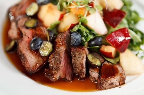 Trent Nelson     The Salt Lake Tribune The Bison Tri-Tip (with stone fruit, fennel, arugula, blueberry) at the restaurant Pallet in Salt Lake City.