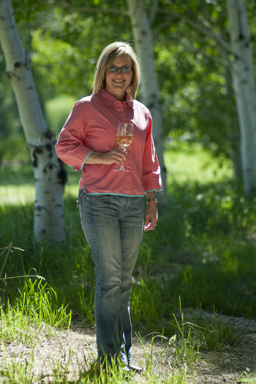 Chris Detrick  |  The Salt Lake Tribune Kirsten Fox, headmistress at the Fox School of Wine, poses for a portrait with a glass of 2011 Kim Crawford Marlborough Unoaked Chardonnay at her home in Park City on Wednesday June 20, 2012.