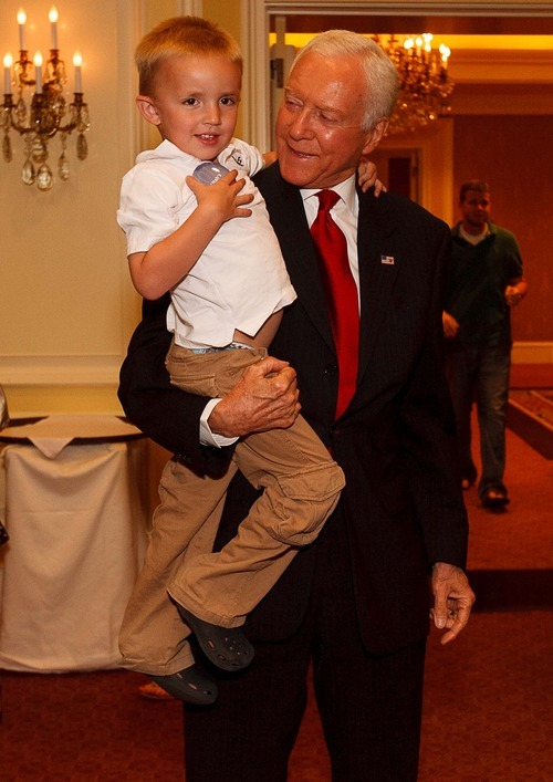 Trent Nelson  |  The Salt Lake Tribune Senator Orrin Hatch holds his great-grandson Jonathan Morgan on election night at the Little America Hotel in Salt Lake City, Utah, Tuesday, June 26, 2012.
