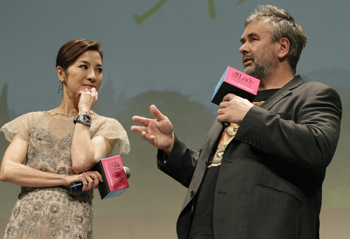 Malaysian actress Michelle Yeoh, listens to French film director Luc Besson during the Japan premiere of their movie The Lady in Tokyo Tuesday, June 26, 2012. Yeoh plays Myanmar opposition leader Aung San Suu Kyi in the movie. (AP Photo/Shizuo Kambayashi)