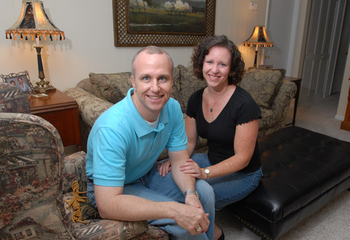 Alan Chambers, left, president of Exodus International, sits with his wife, Leslie, in 2006 in their home in Winter Park, Fla. The president of the country's best-known Christian ministry dedicated to helping people repress same-sex attraction through prayer is trying to distance the group from the idea that gay people's sexual orientation can be permanently changed or