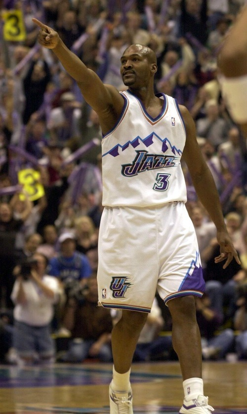 Bryon Russell points to the crowd after hitting one of his two three-pointers in the first half as the Utah Jazz face the Dallas Mavericks in game five of their first round playoff series, in Salt Lake City Thursday. photo by Trent Nelson 05/03/2001