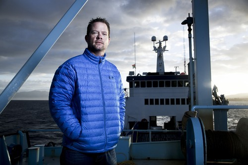 Chris Fischer on the deck of his 126-foot ship. Credit: History Channel