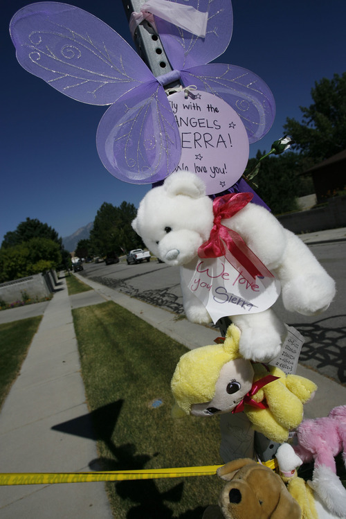 Francisco Kjolseth  |  The Salt Lake Tribune Memorials are put up in the neighborhood around Sierra Newbold's home on Wednesday, June 27, 2012, in West Jordan after she was found dead yesterday morning in a canal near her home after her mother discovered she was missing. A recent autopsy confirmed she had been sexually assaulted and murdered.