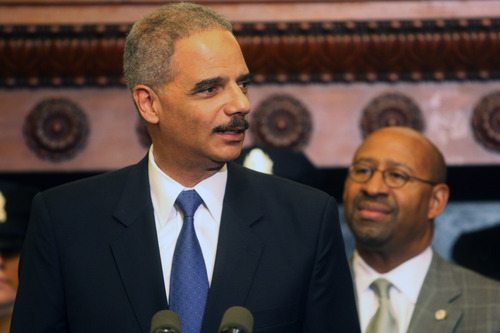Attorney General Eric Holder addresses the media at Philadelphia City Hall on Monday, June 25, 2012. Holder announced more than $111 million in funding for more than 800 law enforcement positions across the country, including 44 in cities in Pennsylvania, through the U.S. Department of Justice Office of Community Oriented Policing Services. (AP Photo/Brynn Anderson)