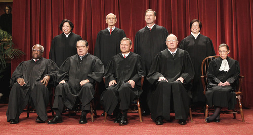 This Oct. 8, 2010 file photo shows the justices of the U.S. Supreme Court at the Supreme Court in Washington. Seated from left are Associate Justices Clarence Thomas, and Antonin Scalia, Chief Justice John Roberts, Associate Justices Anthony M. Kennedy and Ruth Bader Ginsburg. Standing, from left are Associate Justices Sonia Sotomayor, Stephen Breyer, Samuel Alito Jr., and Elena Kagan.  The Supreme Court on Thursday, June 28, 2012, upheld the individual insurance requirement at the heart of President Barack Obama's historic health care overhaul. (AP Photo/Pablo Martinez Monsivais, File)