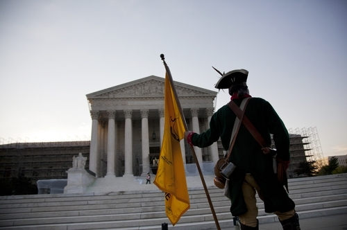 William Temple, of Brunswick, Ga., waits outside the Supreme Court a  landmark decision on health care on Thursday, June 28, 2012 in Washington.  (AP Photo/Evan Vucci)