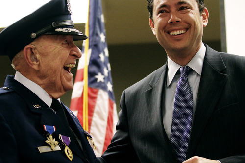 Rep. Jason Chaffetz laughs with WWII veteran Col. Myron