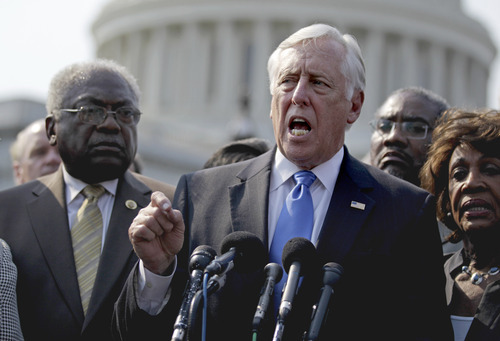 House Minority Whip Steny Hoyer of Md., flanked by House Assistant Minority Leader James Clyburn of S.C., left, and Rep. Maxine Waters, D-Calif., speaks to reporters on Capitol Hill in Washington, Thursday, June 28, 2012, after some members of Congress walked off the House floor in protest of a contempt of Congress vote for Attorney General Eric Holder. (AP Photo/David Goldman)
