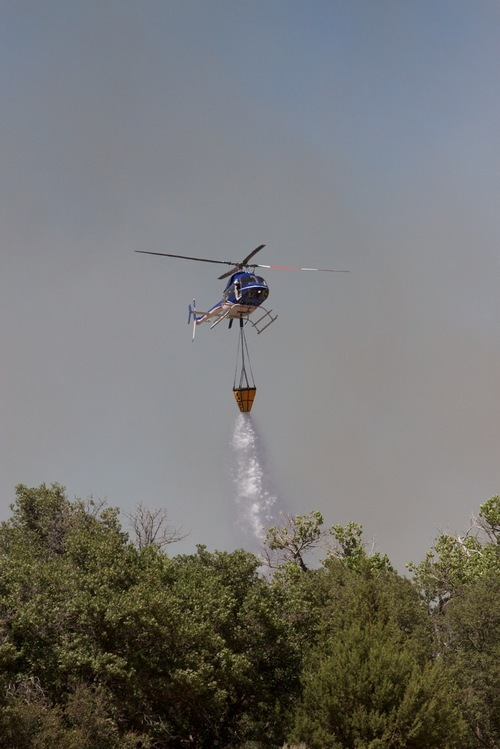 An Air Attack Helicopter douses the New Harmony Fire. (Kyle Kester)