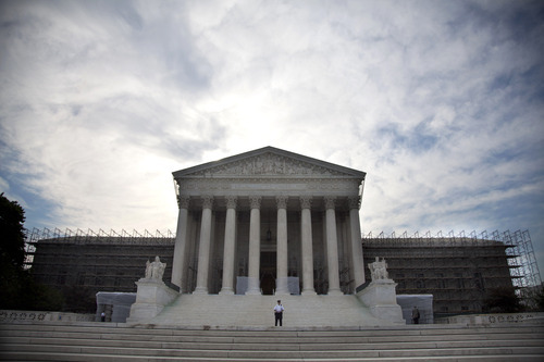 The Supreme Court in Washington, Monday, June 25, 2012.  The Supreme Court ruled Monday that it is unconstitutional for state laws to require juveniles convicted of murder to be sentenced to life in prison without possibility of parole.  (AP Photo/Evan Vucci)