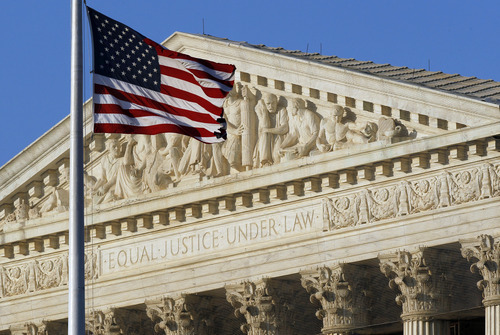 An American flag flies in front of the U.S. Supreme Court on the eve of Thursday's expected ruling on whether or not the Affordable Care Act passes the test of constitutionality Wednesday, June 27, 2012 in Washington. (AP Photo/Alex Brandon)
