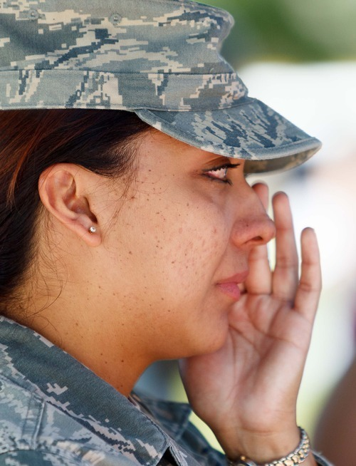 Trent Nelson  |  The Salt Lake Tribune Alicia Estrada wipes away tears during a retirement ceremony for four military working dogs held by the 75th Air Base Wing Security Forces at Hill Air Force Base on Friday, June 29, 2012.