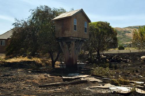 Chris Detrick  |  The Salt Lake Tribune Damage caused from the Rose Crest Fire in Herriman Saturday June 30, 2012.