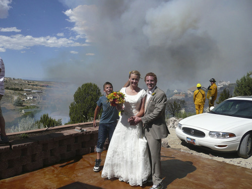 Monique Balazs Babcock and Brandon Babcock (bride/groom) were married Friday and were preparing for a backyard reception at her mother's Herriman home when the Rose Crest Fire forced postponement of their reception. Photo Courtesy: Dianne Carr