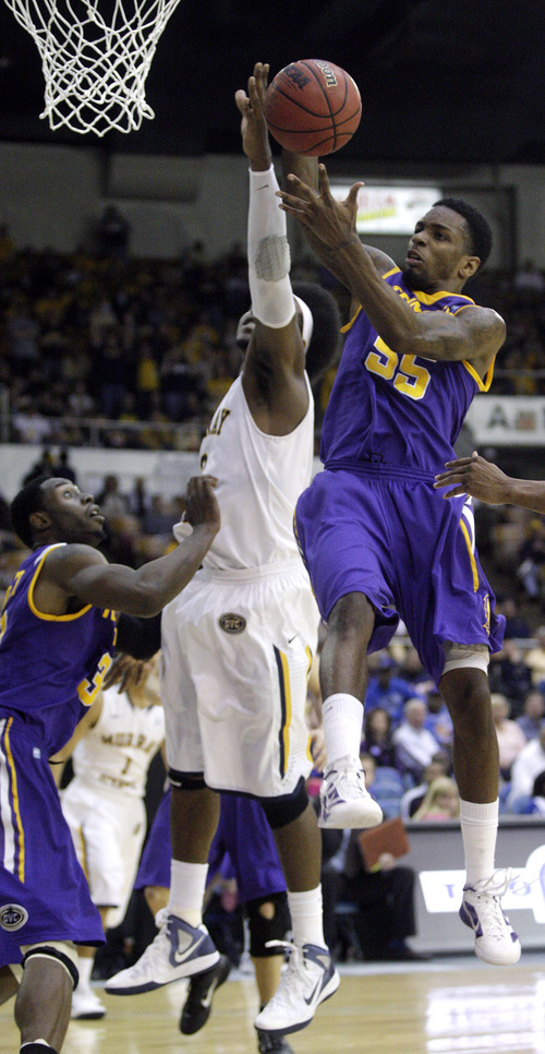 Tennessee Tech's Kevin Murphy (55) grabs a rebound from Murray State's Edward Daniel (2) in the first half of an NCAA college basketball game on Friday, March 2, 2012, in Nashville, Tenn. (AP Photo/Wade Payne)