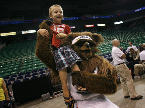 Scott Sommerdorf  |  The Salt Lake Tribune              The Jazz Bear lifts up Connor Anderson as he poses with fans during an event in Salt Lake City during the early part of the first round of the NBA draft on Thursday, June 28,  well before the Jazz picked much later at #47.