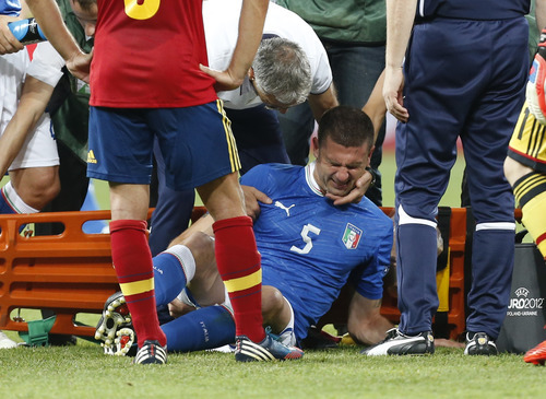 Italy's Thiago Motta receives assistance during the Euro 2012 soccer championship final  between Spain and Italy in Kiev, Ukraine, Sunday, July 1, 2012. (AP Photo/Jon Super)