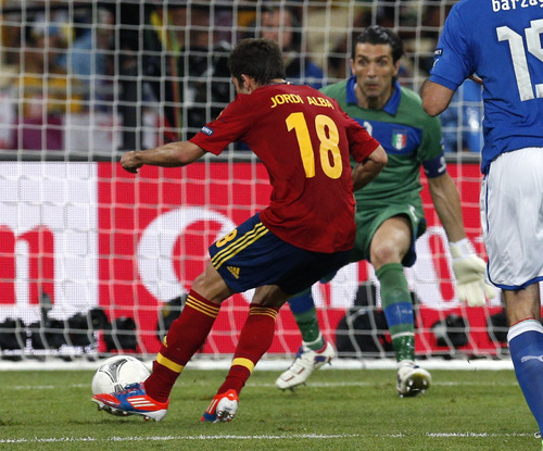 Spain's Jordi Alba scores the second goal past Italy goalkeeper Gianluigi Buffon during the Euro 2012 soccer championship final  between Spain and Italy in Kiev, Ukraine, Sunday, July 1, 2012. (AP Photo/Michael Sohn)