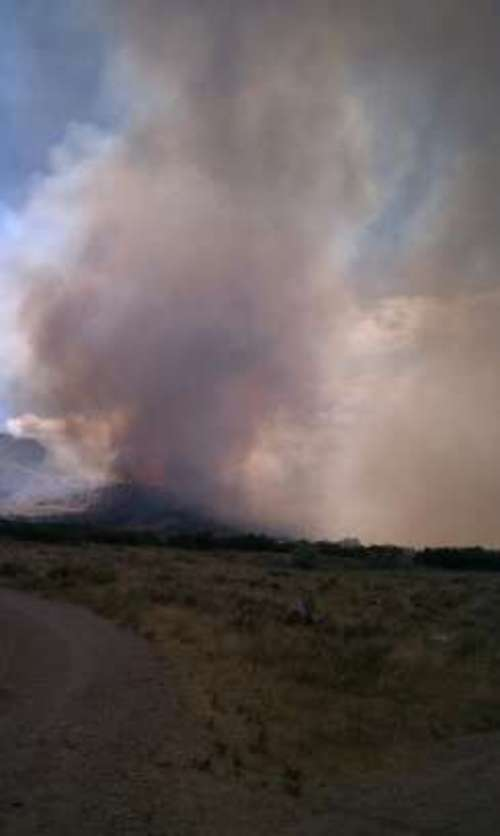 View from a driveway as fire takes off in Herriman near the Cove subdivision. Courtesy image.