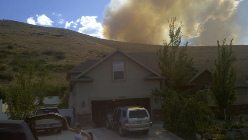 Annemieke Okamura | Courtesy photo Annemieke White Okamura shot this photo of the wildfire burning Friday in the foothills near Herriman from Rose Summit Drive.