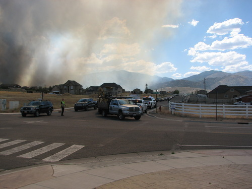 Robert Kirby | The Salt Lake Tribune A fire burning Friday afternoon in the foothills near Herriman forced mandatory evacuations from 13300 South to 14500 South from 7200 West to 8200 West.