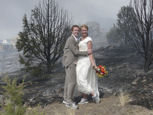 Monique Balazs Babcock and Brandon Babcock (bride/groom) were married Friday afternoon and were preparing for a backyard reception at her mother's Herriman home when the Rose Crest Fire forced postponement of their reception. Photo Courtesy: Dianne Carr
