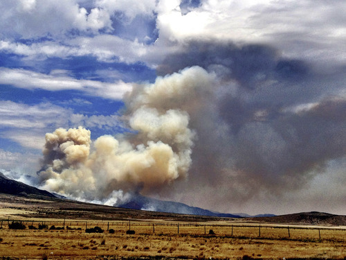 Chris Detrick  |  The Salt Lake Tribune Smoke rises from the Clay Springs Fire near Scipio, in Millard County, Utah, on Sunday, July 1, 2012.