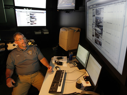 Al Hartmann  |  The Salt Lake Tribune  Ogden Police crime analyst Dave Weloth reads the license plate history of a truck in the Real Time Crime Center. The plate has been scanned over several days by a specially equipped Ogden police car that can read license plates with its four roof-mounted cameras. Agencies around the state are using license plate scanners to aid highway and street patrol cars in apprehending criminals. They can determine if the car's registration and insurance are up to date.