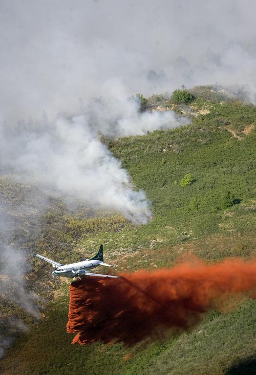 Kim Raff | The Salt Lake Tribune An airplane drops flame retardant on the Quail Wildfire in Alpine on Tuesday July 3, 2012.